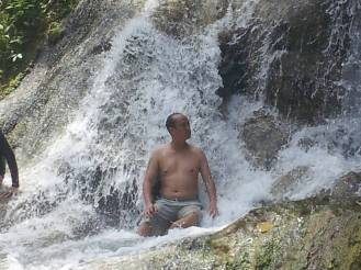 sitting under the falls